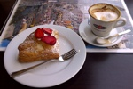 Typical breakfast of pastry & cappucino